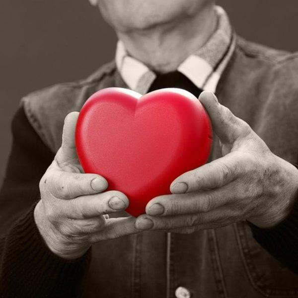 Man holding heart shape